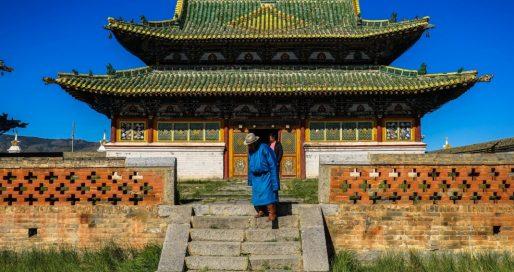 Local dressed in traditional gear leaving Erdene Zuu Khid.